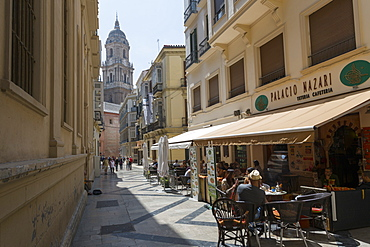 Malaga Cathedral and cafe in narrow street, Malaga, Costa del Sol, Andalusia, Spain, Europe