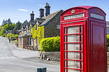 Red telephone box in Beeley Village in springtime, Derbyshire Dales, Derbyshire, England, United Kingdom, Europe