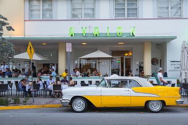 View of Art Deco architecture of Avalon Hotel and classic car, South Beach, Miami Beach, Miami, Florida, United States of America, North America