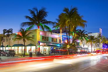 Ocean Drive restaurants and Art Deco architecture at dusk, South Beach, Miami Beach, Miami, Florida, United States of America, North America