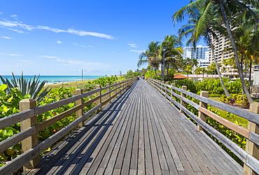 Boardwalk along South Beach towards Ocean Drive, Miami Beach, Miami, Florida, United States of America, North America