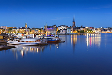 View of Riddarholmen and Sodermalm at dusk from near Town Hall, Stockholm, Sweden, Scandinavia, Europe