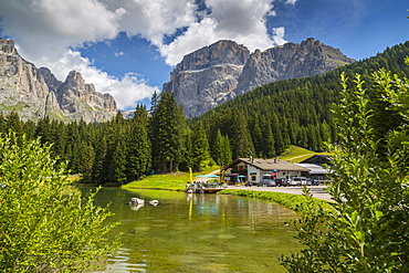Lake near Hotel Lupo Bianco Wellness and  Walking Canazei, Passo Pordoi with mountain backdrop, South Tyrol, Italian Dolomites, Italy, Europe