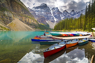 Tranquil setting of rowing boats on Moraine Lake, Banff National Park, UNESCO World Heritage Site, Canadian Rockies Alberta, Canada, North America