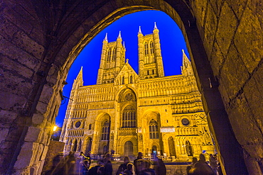 Lincoln Cathedral viewed through archway of Exchequer Gate at dusk, Lincoln, Lincolnshire, England, United Kingdom, Europe