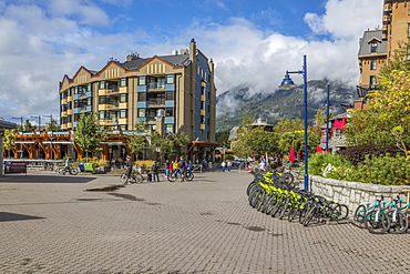 Cycles and shops aligning Skiers Plaza, Whistler Village, British Columbia, Canada, North America