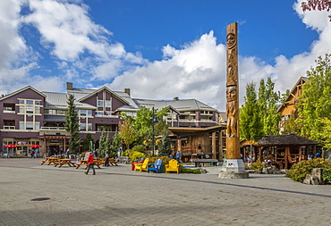 Totem Pole and shops on Whistler Olympic Plaza and Village Stroll, Whistler Village, British Columbia, Canada, North America