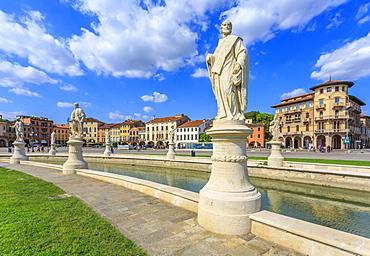 View of statues in Prato della Valle and colourful architecture  in the background, Padua, Veneto, Italy, Europe