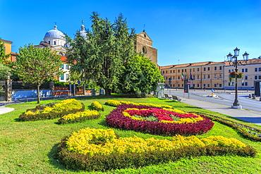 View of gardens in Prato della Valle and Santa Giustina Basilica visible in background, Padua, Veneto, Italy, Europe