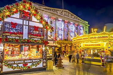 Christmas Market, Carousel and City Council Building on Old Market Square at dusk, Nottingham, Nottinghamshire, England, United Kingdom, Europe