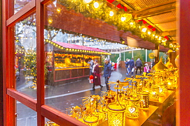 Christmas Market Stalls and shoppers in Leicester Square, London, England, United Kingdom, Europe