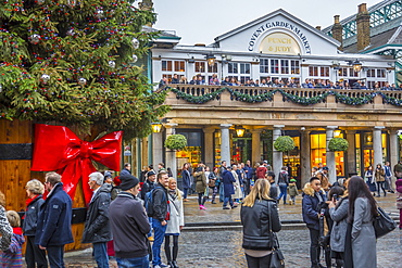 Visitors and Christmas decorations in Covent Garden Market, London, England, United Kingdom, Europe