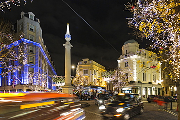 View of traffic at Seven Dials at night, London, England, United Kingdom, Europe