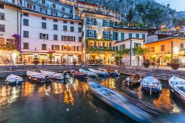 View of illuminated promenade at the port of Limone at dusk, Lake Garda, Lombardy, Italian Lakes, Italy, Europe