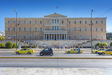 Parliament building and yellow cabs in Syntagma Square, Athens, Greece, Europe