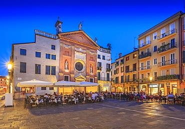 View of cafes and Chiesa di San Clemente in Piazza dei Signori at dusk, Padua, Veneto, Italy, Europe