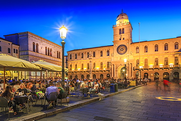 View of cafes and Torre Dell'Orologio in Piazza dei Signori at dusk, Padua, Veneto, Italy, Europe
