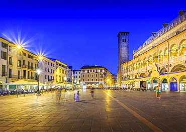 Cafes and Tower of Anziani in Piazza della Frutta at dusk, Ragione Palace is visible, Padua, Veneto, Italy, Europe