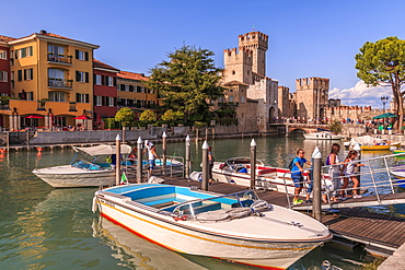 View of Scaliger Castle and boats in harbour, Sirmione, Lake Garda, Lombardy, Italian Lakes, Italy, Europe