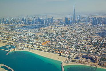 View of city skyline and Dubai Beach from seaplane, Dubai, United Arab Emirates, Middle East