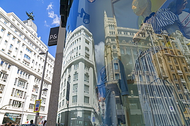 View of Buildings reflecting in designer shop window on Gran Via, Madrid, Spain, Europe