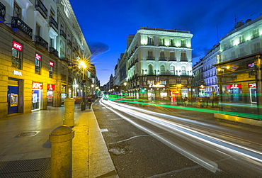 Trail lights and Architecture at Puerta del Sol at dusk, Madrid, Spain, Europe