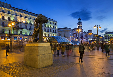 View of Bear and Strawberry Tree statue and Puerta Del Sol at dusk, Madrid, Spain, Europe