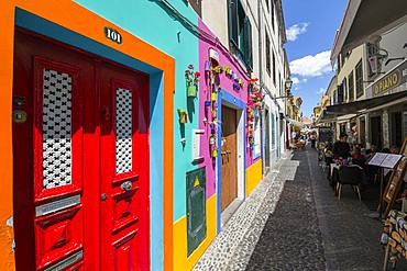 View of back street colourful doors and restaurant, Funchal, Madeira, Portugal, Atlantic, Europe