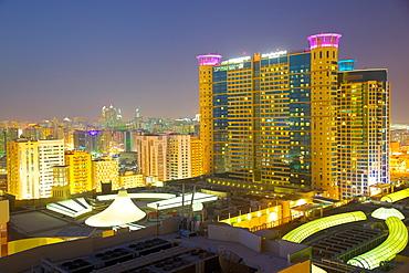 Grand Millennium Hotel and Al Wahda Mall at dusk, Abu Dhabi, United Arab Emirates, Middle East