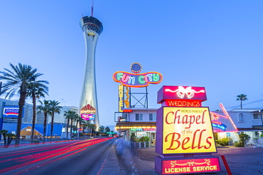View of Chapel of the Bells and Stratosphere Tower at dusk, The Strip, Las Vegas Boulevard, Las Vegas, Nevada, United States of America, North America