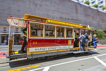 Fast moving cable car on Powell Street, San Francisco, California, United States of America, North America