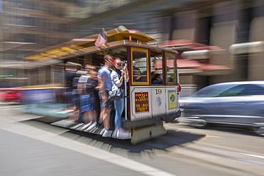 Fast moving cable car in Union Square, San Francisco, California, United States of America, North America