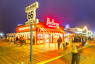 View of shops and Route 66 End of Trail sign on Santa Monica Pier, Santa Monica, Los Angeles, California, United States of America, North America