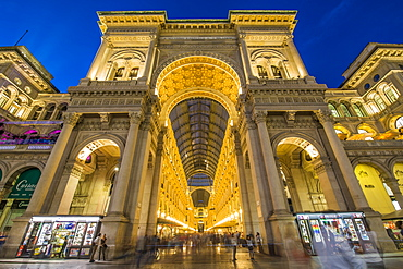 View of Galleria Vittorio Emanuele II in Piazza Del Duomo illuminated at dusk, Milan, Lombardy, Italy, Europe