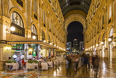 View of the interior of Galleria Vittorio Emanuele II illuminated at dusk, Milan, Lombardy, Italy, Europe