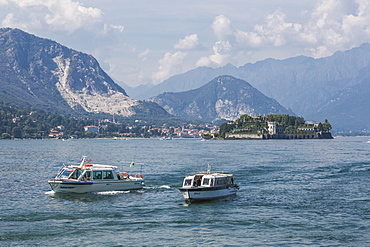 View of taxi boats returning from Isola Bella, Borromean Islands from Stresa, Lago Maggiore, Piedmont, Italian Lakes, Italy, Europe