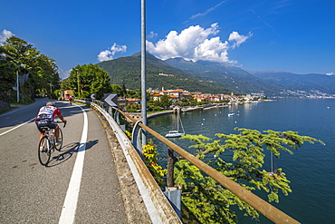 Cyclists on road leading to Cannobio and Lake Maggiore, Lake Maggiore, Piedmont, Italian Lakes, Italy, Europe