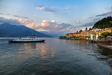 View of Lake Como and ferry arriving at Bellagio at sunset, Province of Como, Lake Como, Lombardy, Italian Lakes, Italy, Europe