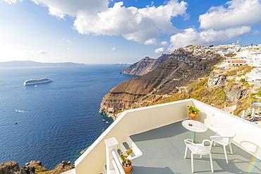 View of Fira white washed houses and cruise ship, Firostefani, Santorini (Thira), Cyclades Islands, Greek Islands, Greece, Europe