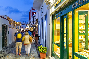 View of busy shopping street in Fira at dusk, Fira, Firostefani, Santorini (Thira), Cyclades Islands, Greek Islands, Greece, Europe