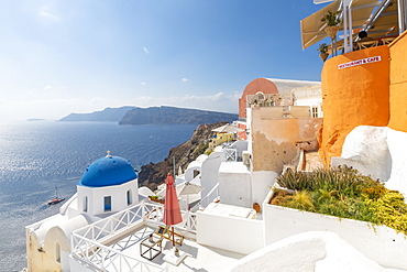 View of blue domed church from cafe in Oia village, Santorini, Cyclades, Aegean Islands, Greek Islands, Greece, Europe