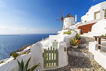 View of windmill overlooking Oia village, Santorini, Cyclades, Aegean Islands, Greek Islands, Greece, Europe