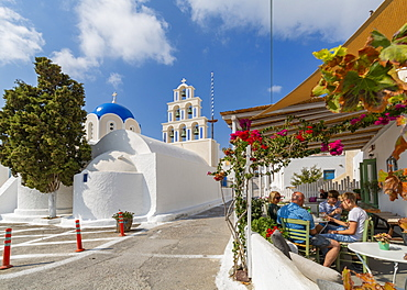 St. Epifanios Traditional Orthodox Church by restaurant in Akrotiri, Thira, Santorini, Cyclades Islands, Greece, Europe