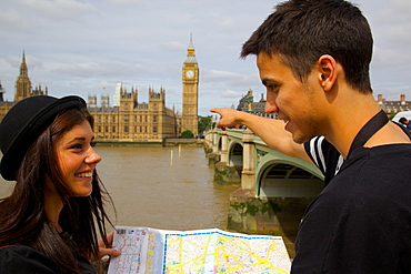 Big Ben and young couple looking at map, London, England, United Kingdom, Europe