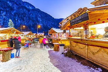 Christmas market at sunset in Campitello di Fassa, Val di Fassa, Trentino, Italy, Europe