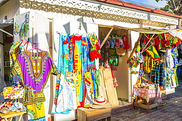 Traditional colourful clothing on Melville Street in St. George's, Grenada, Windward Islands, West Indies, Caribbean, Central America