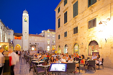 Clock tower and restaurants at dusk, Stradun, UNESCO World Heritage Site, Dubrovnik, Dalmatian Coast, Dalmatia, Croatia, Europe