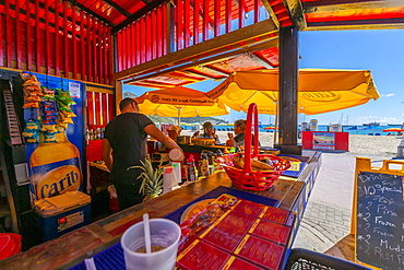 View of beach and Caribbean Sea from beach bar, Philipsburg, St. Maarten, Leeward Islands, West Indies, Caribbean, Central America