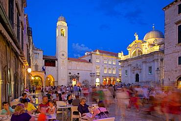 Clock tower and restaurants at dusk, Stradun, UNESCO World Heritage Site, Dubrovnik, Dalmatian Coast, Dalmatia, Croatia, Europe
