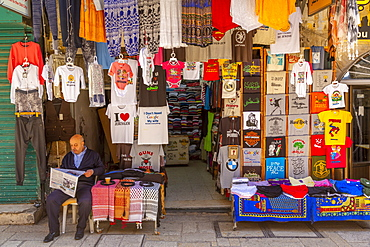 Colourful clothes, Souk Khan al-Zeit Street in Old City, Old City, UNESCO World Heritage Site, Jerusalem, Israel, Middle East